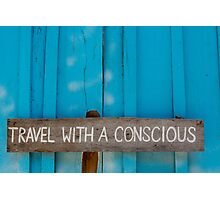 Travel with a conscious wooden sign on blue wooden background Photographic Print