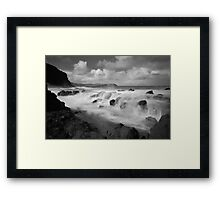 The Clash of Land and Sea Framed Print