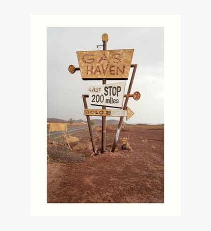 Tall vintage gas sign standing in the desert Art Print