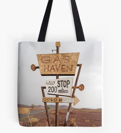 Tall vintage gas sign standing in the desert Tote Bag