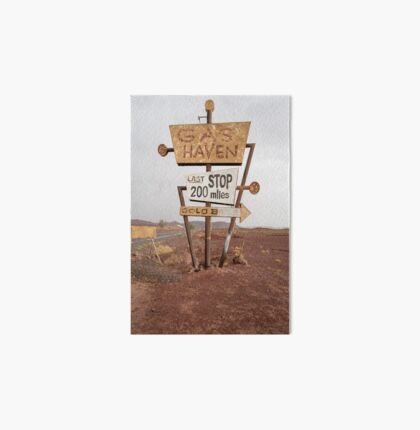Tall vintage gas sign standing in the desert Art Board