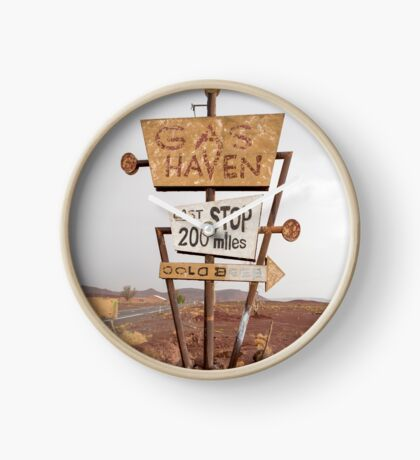 Tall vintage gas sign standing in the desert Clock