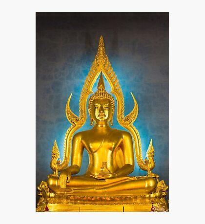Illuminated golden Buddha inside a Thai temple Photographic Print