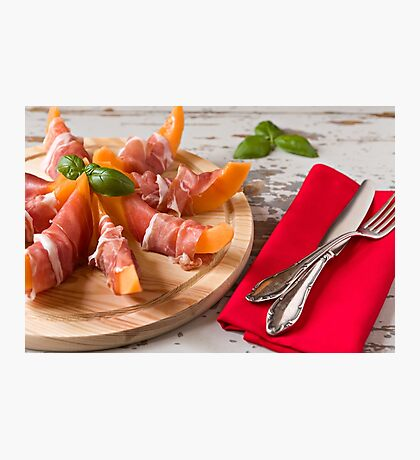 Cutting board with prosciutto and melon Photographic Print