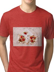 Strawberries cereals and chocolate flakes inside the plain yogurt Tri-blend T-Shirt