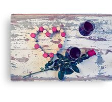 Two glasses of red wine and a heart with corks Canvas Print
