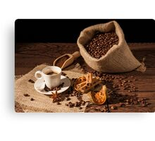 Coffee cup with cinnamon, star anise and dried orange fruit Canvas Print