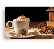 Close-up of coffee cup with whipped cream and star anise Canvas Print