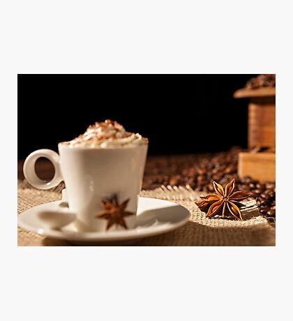 Close-up of coffee cup with whipped cream and star anise Photographic Print