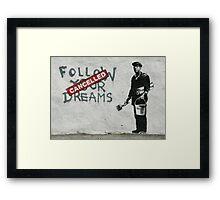 Banksy - follow your dreams canceled Framed Print