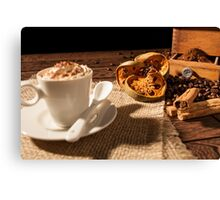 Close-up of coffee cup, dried orange fruit and cinnamon sticks Canvas Print