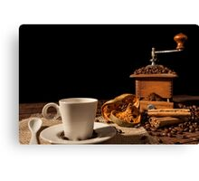 Coffee cup, dried orange fruit, cinnamon sticks and coffee grinder Canvas Print