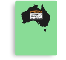 WARNING: CURRENTLY OPERATED BY A MORON Canvas Print