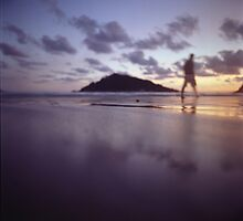 Man walking on beach dusk sunset evening sky Hasselblad medium format film analogue photograph by edwardolive