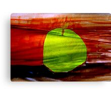 Green apple on red background Canvas Print
