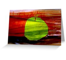 Green apple on red background Greeting Card