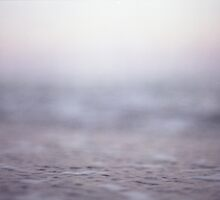 Coastal shoreline at low tide in pink grey purple semi abstract Mamiya 645 medium format film analog photo by edwardolive