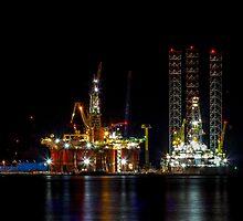 Oil Rig At Night by derekbeattie