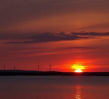 Wind turbines at sunset by chris2766