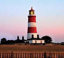 Happisburgh lighthouse shining by Avril Harris
