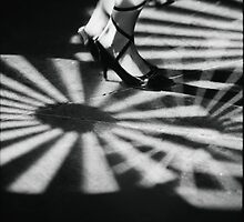 Feet of girl dancing in nightclub lights black and white silver gelatin 35mm film analog photograph by edwardolive
