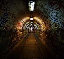 Dark and long undergorund passage with light by iWorkAlone