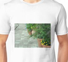 Plants in flower pots on the pavement Unisex T-Shirt