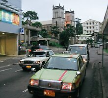 Taxi Cabs on a Side Street in Suva, Fiji by wellfinished
