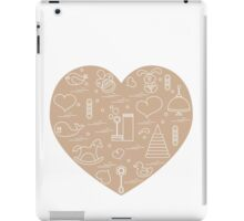 Vector illustration kids elements arranged in a heart: bird, whale, pacifier, bubbles, pyramid, beanbag, rabbit, duck and other. iPad Case/Skin