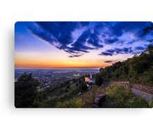 Sunset from a hill with a church down to the vineyards Canvas Print