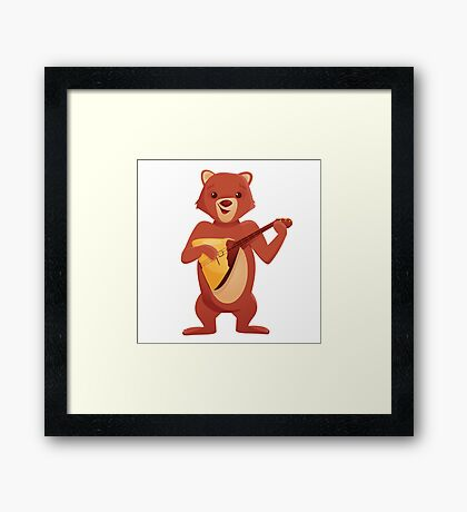 Happy cartoon bear playing music with balalaika Framed Print