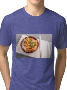 Asian dish of rice noodles in a small brown wooden bowl Tri-blend T-Shirt