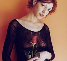Lingerie model with a rose by Rob Emery