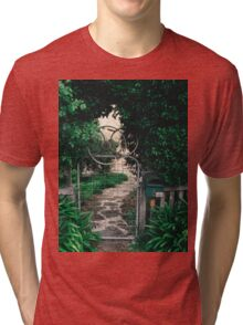 Leafy gate with a bicycle wheel decoration Tri-blend T-Shirt