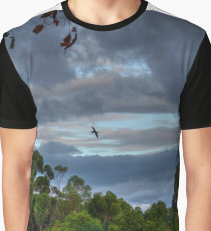 Lone bird flying in the stormy sky Graphic T-Shirt