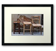chair in the street Framed Print