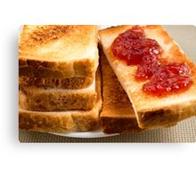 Toasted slices of bread with strawberry jam close-up Canvas Print