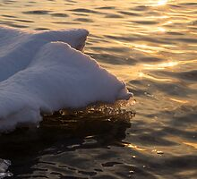 Happy Sunset Ice - the Icy Snowbanks Reflecting in the Lake by Georgia Mizuleva