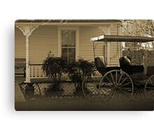 Old house and wagon Canvas Print