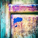 Blue in rusty door by Silvia Ganora
