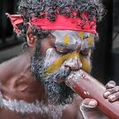 Aboriginal Playing Didgeridoo by Jola Martysz