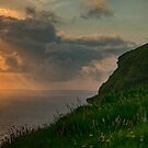 Cliffs of moher sunset in county clare ireland with castle tower over looking aran islands on the wild atlantic way by Noel Moore Up The Banner Photography