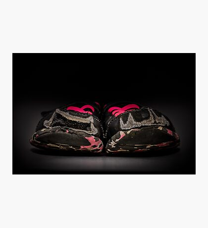 Old and dirty grey girl's sneakers isolated on black background Photographic Print