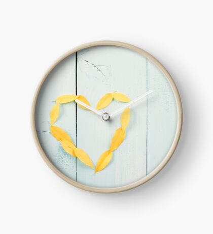 Heart Shape Yellow Autumn Leaves On Turquoise Wood Table Clock