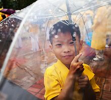 Boy Sheltering From the Rain by koreanrooftop