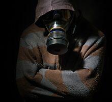 Man in gasmask against dark background by Anna Váczi