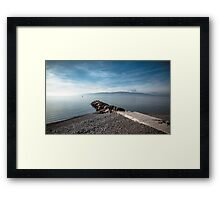Sea at sunset with rocks Framed Print