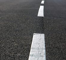 Asphalt of a road closeup photo by Anna Váczi