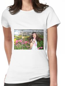 Young preteen girl of 12 in white dress in a hothouse of pink flowers  Womens Fitted T-Shirt