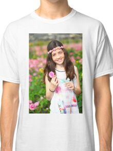 Young preteen girl of 12 in white dress in a hothouse of pink flowers  Classic T-Shirt